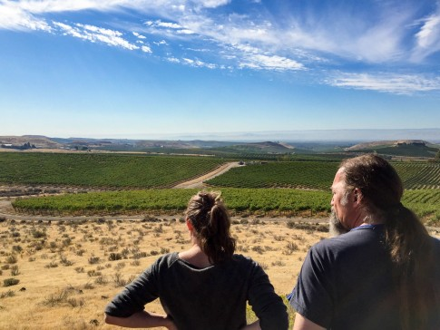 Mark & Renee look down the mountain and over the vineyard toward the Gorge